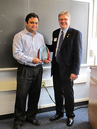 Dale Hoffman presenting the career award to Arnab Roy