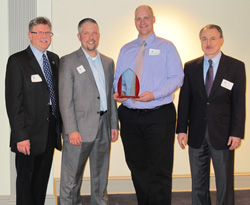 Dale Hoffman, Paul Mittan, Ben Campbell, Kultegin Aydin posing with Campell's career award