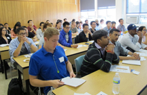 grad students listening to information presented to them during graduate student orientation