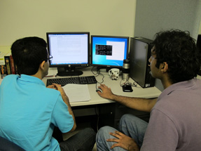 Two students working on a problem on the computer